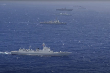 What Chinese hidden purposes of its military drills in the South China Sea?