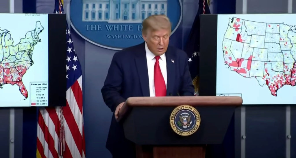 US President Donald Trump points to map of reported coronavirus cases as he speaks about reopening schools during a coronavirus news briefing at the White House in Washington