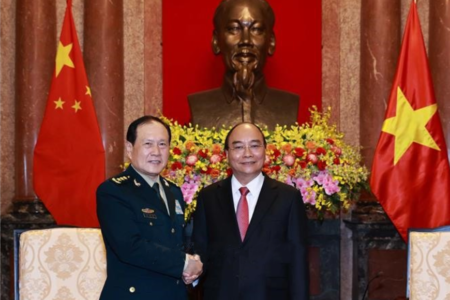 Has Vietnam President Nguyen Xuan Phuc pledged not to partner with another country against China?
